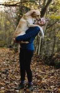 Woman Holding Large Dog